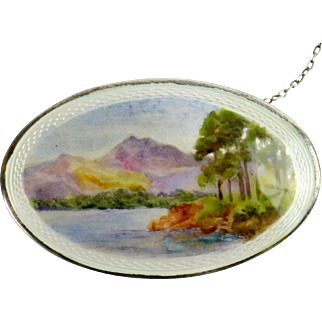 Rare and unusual early 20th century oval silver and guilloche enamel hand painted brooch.