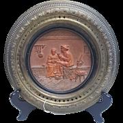 German Terracotta wall plate in brass frame
