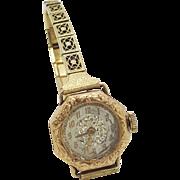 A vintage Wadsworth Swiss 14K gold ladies watch etched filigree