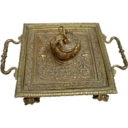 A heavy antique brass inkwell highly detailed.