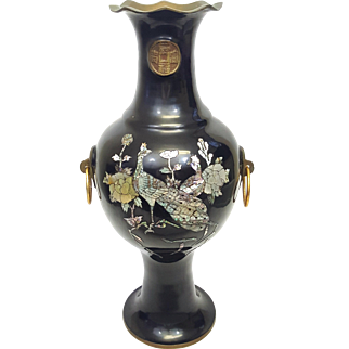 A vintage Japanese brass vase with black lacquer and mother of pearl