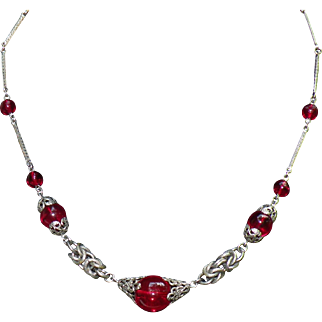 Vintage  Jakob Bengel necklace poured red glass beads intricate chrome metalwork.