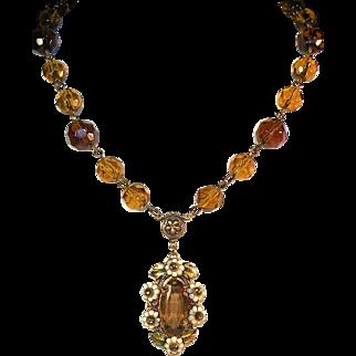 Czechoslovakian lavaliere rhinestone necklace hand cut crystal beads floral motif.
