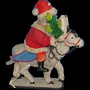 Old machine Santa Claus riding on donkey * thirties