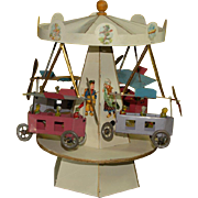 Old flyer carousel made of sheet metal with clockwork train * probably Nuremberg twenties