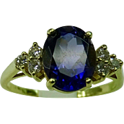 Oval Iolite in 18K gold ring with 6 side diamonds