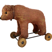 Antique Steiff cinnamon bear on wheels