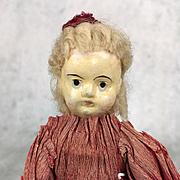 Antique tiny unusual papier mache doll in original clothing