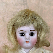 Antique all bisque sweet miniature doll with sleep eyes