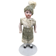 Vintage dollhouse boy in crocheted romper and hat