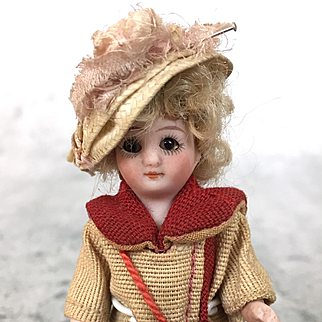Antique miniature German tiny all bisque doll in wonderful clothing