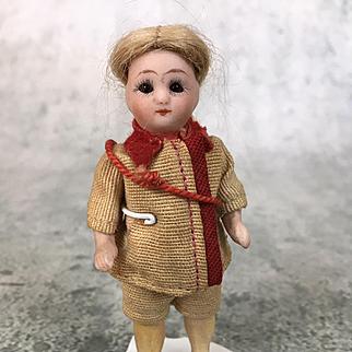 Antique miniature German all bisque doll in original clothing