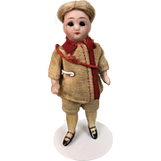 Antique miniature German all bisque doll in original clothing