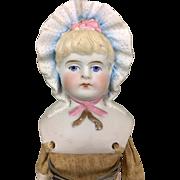 Antique bonnet head parian doll with gold bow