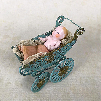 Antique soft metal dollhouse baby carriage with bisque baby