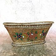 Old woven straw basket with floral painting