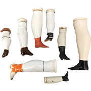Group of eight antique china doll legs