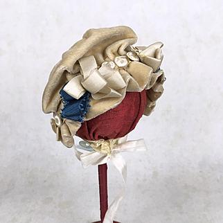 Antique ruffled velvet doll's bonnet
