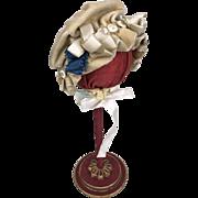 Old ruffled velvet doll's bonnet