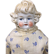 Antique china doll with cafe au lait hair