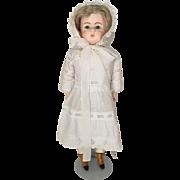 Antique papier mache doll in near mint condition
