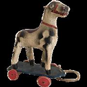 Antique papier mache and wood horse toy