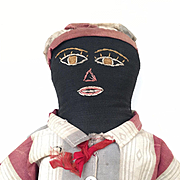 Vintage handmade black boy doll