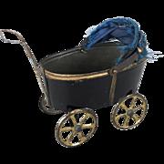 Antique miniature tin baby carriage