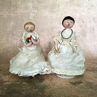 Antique or vintage dolls of wrapped wire in fabulous clothing, pair of ladies