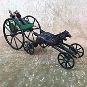 Cast iron toy horses and cart