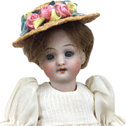 Antique bisque miniature doll, sleep eyes, lovely dress, miniature doll with hat