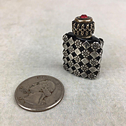 Antique miniature glass perfume bottle with metal sheath
