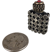 Miniature glass perfume bottle with metal sheath