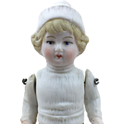 All bisque miniature boy doll