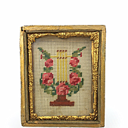 Antique miniature needlepoint in ormolu frame, Victorian frame with needlework