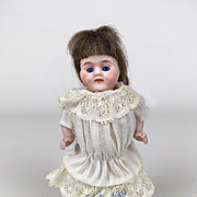 Antique all bisque miniature girl doll