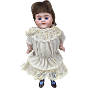 All bisque miniature girl doll