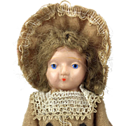 Vintage celluloid and composition doll in wool dress, perfect doll's doll