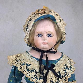 Antique German papier mache doll, papier mache doll with glass eyes, beautiful clothing