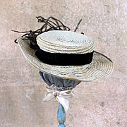 Doll sized straw hat with feathers