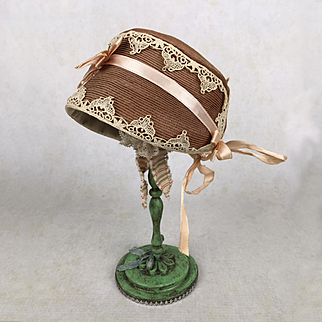 Vintage light brown doll's bonnet