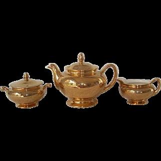 3 Pc. Gold Trimmed  Eggshell Nautilus Teapot, Sugar Bowl and Creamer, Homer Laughlin