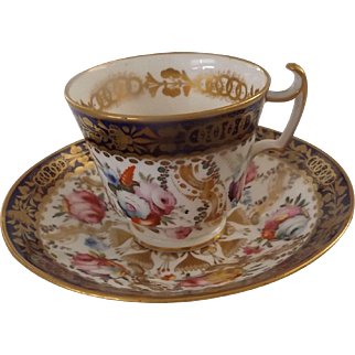 Early 19th Century English Cup and Saucer with Stunning Hand Painted Flowers