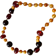 Heavy bakelite necklace, hand knotted mix faux amber, black cherry, honey swirl, 1930s