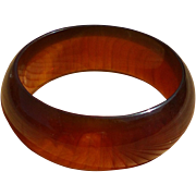Heavy root beer bakelite bangle, semi-translucent faux amber, chunky 1940s, tested