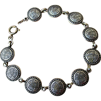 Celtic link bracelet from Brittany, mid-century silver plate on brass with Triskel symbol