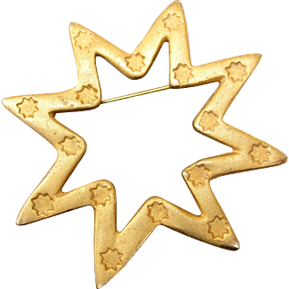 French collectible star brooch by Lancôme in matte / satin gold-tone metal