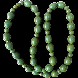 Long, heavy jade green bakelite necklace