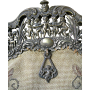 Antique French tapestry purse bag with decorative white metal cherub frame circa 1900