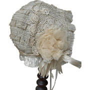 French Napoleon III lace baby bonnet with silk rosettes & velvet ribbons 1890s